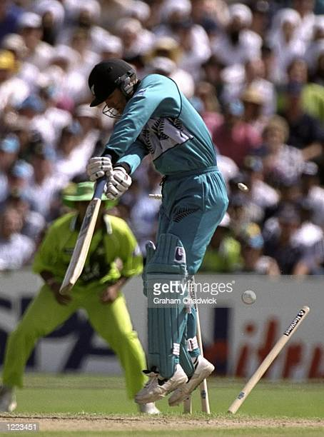 Nathan Astle of New Zealand is bowled during the World Cup semifinal against Pakistan at Old Trafford in Manchester England Pakistan won by 9 wickets...