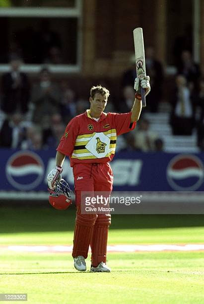 Neil Johnson of Zimbabwe reaches his century against Australia in the World Cup Super Six match at Lord's in London. Australia won by 44 runs. \...