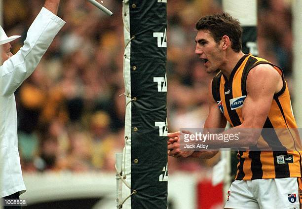 Nick Holland number two for Hawthorn shows his elation to the goal umpire after scoring a goal after a previous controversial decision went against...