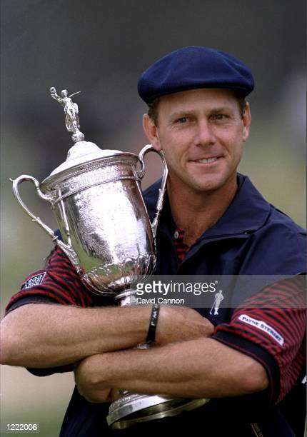 Payne Stewart of the United States clutches the trophy after winning the 1999 US Open played on the number two course at Pinehurst in North Carolina...