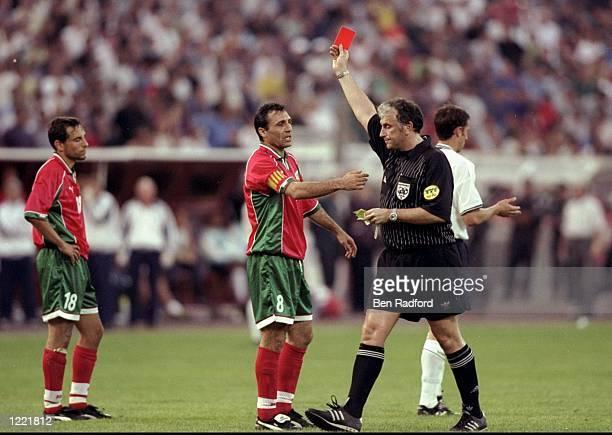 Referee Mario van der Ende sends off Martin Petrov of Bulgaria despite the protests of team mate Hristo Stoichkov in the European Championship...
