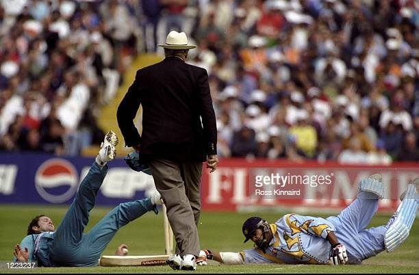 Robin Singh of India is run out by Chris Cairns of New Zealand in the World Cup Super Six match at Trent Bridge in Nottingham England New Zealand won...