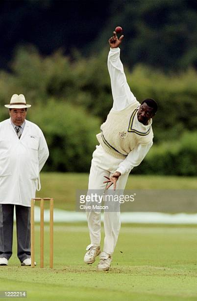 Roger Harper the former West Indies player bowls during the Allsport Cricket Match at Wormsley in England Mandatory Credit Clive Mason /Allsport