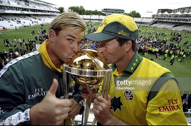 Shane Warne and Steve Waugh of Australia kiss the trophy after victory over Pakistan in the Cricket World Cup Final at Lord's in London Australia won...