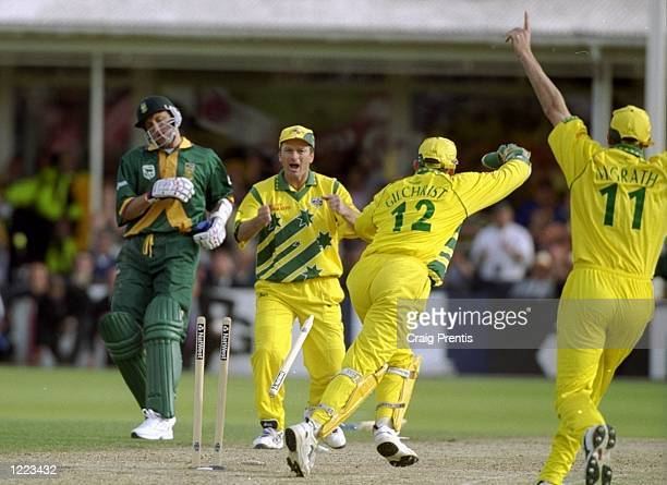 Steve Waugh celebrates as Allan Donald of South Africa is run out and Australia go through to the World Cup final after a dramatic semi-final at...