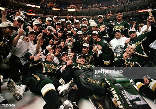 The Dallas Stars pose for a team photo with the Stanely Cup trophy as they celebrate the win over the Buffalo Sabres at the Marine Midland Arena in...