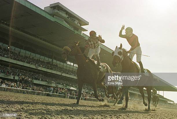 Vision and Verse jockey Heberto Castillo high five''s Lemon Drop Kid''s jockey Jose Santos after Lemon Drop Kid won the 131st Belmont Stakes at...