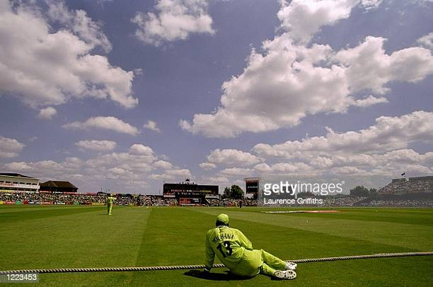 Yousuf Youhana of Pakistan watches from the boundary after missing the World Cup semifinal against New Zealand through injury at Old Trafford in...