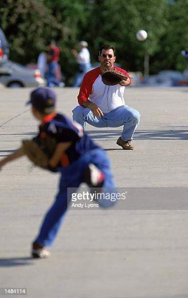 General view of tail gaters as they play catch taken during the College World Series at the Resenblatt Stadium in Omaha, Nebraska. Mandatory Credit:...