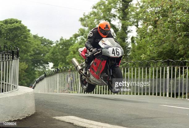Adam Donovan takes Ballaugh Bridge during the Isle of Man TT Races on the Isle of Man Great Britain Mandatory Credit Ian Walton /Allsport