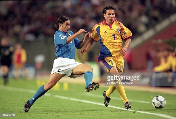 Adrian Mutu of Romania beats Fabio Cannavaro of Italy during the European Championships 2000 Quarter Final at the King Baudouin Stadium, Brussels,...