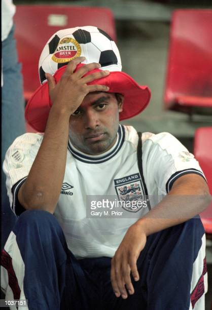 An England fan holds his head after the European Championships 2000 group match against Portugal at the Philips Stadium in Eindhoven, Holland....