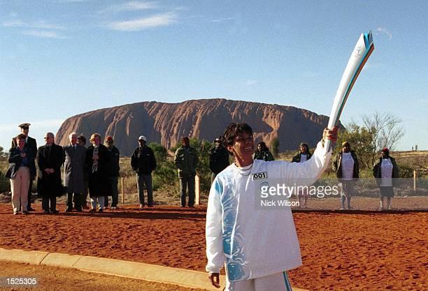 Australian Olympian Nova PerisKneebone who is the only Aboriginal Olympic Gold medal winner prepares to run through ''Uluru'' on the first stage of...