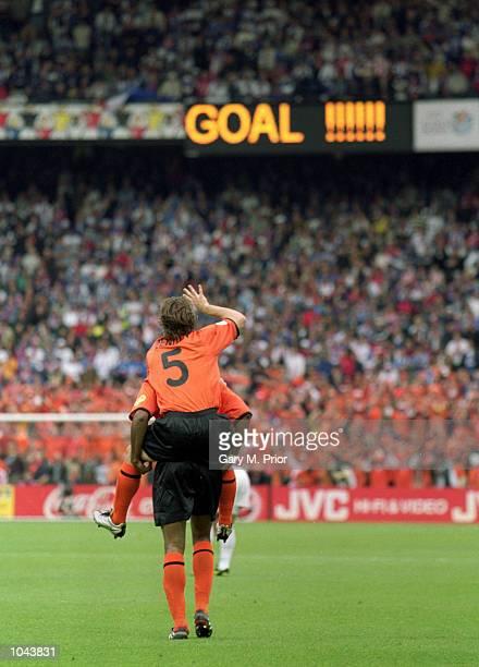 Boudewijn Zenden of Holland congratulates teammate Patrick Kluivert during the European Championships 2000 quarter-final against Yugoslavia at the De...