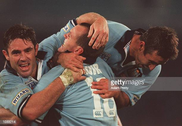 Brad Fittler and Andrew Johns congratulate Adam Muir of NSW after scoring a try during the State of Origin clash between NSW and Queensland at...