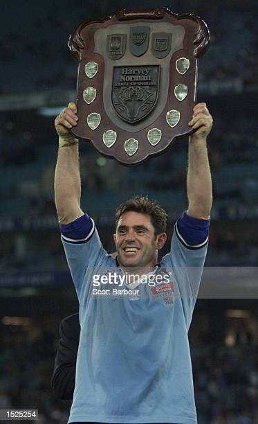 Captain Brad Fittler of New South Wales holds the trophy aloft after defeating Queensland 5616 in game three of the State of Origin Rugby League...