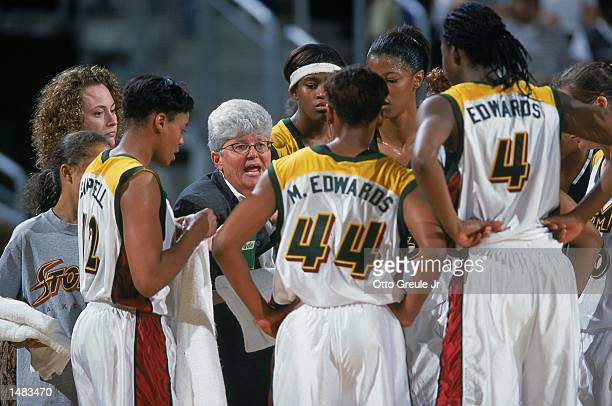 Coach Lin Dunn of the Seattle Storm talks to the players during the game against the Utah Starzz at Key Arena in Seattle Washington The Starzz...