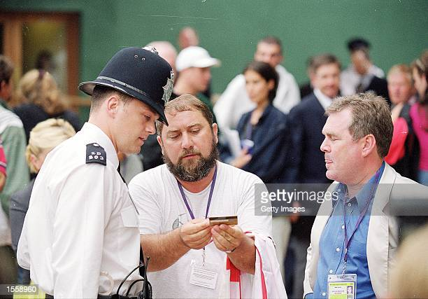Damir Dokic Jelena Dokic father and coach talks to the police during Wimbledon 2000 at Wimbledon London England Mandatory Credit Allsport UK /Allsport
