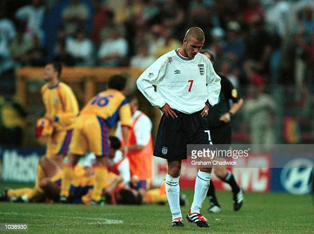 David Beckham shows his despair after England's 32 defeat by Romania in the EURO 2000 Group A match at the Stade du Pays Charleroi Belgium Mandatory...