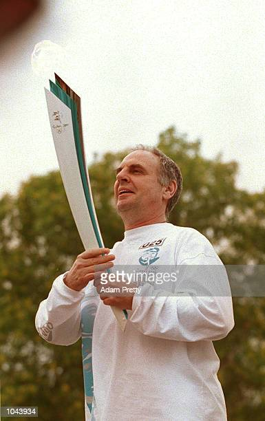 Dr Philip Nitschke of Australia advocate for Euthenasia runs with the Sydney Olympic torch during the Darwin leg of the Torch Relay Mandatory Credit...