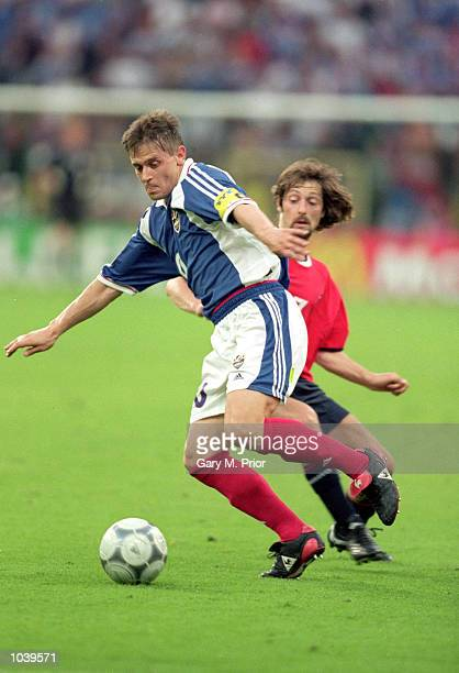 Dragan Stojkovic of Yugoslavia evades the tackle by Erik Mykland of Norway during the European Championships 2000 Group Stage match at the Sclessin...