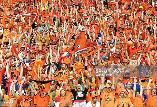 Dutch fans enjoy the action during the European Championships 2000 group match against the Czech Republic at the Amsterdam Arena in Amsterdam,...