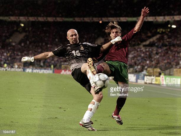 Fabien Barthez of France challenges Joao Pinto of Portugal during the European Championships 2000 semifinal at the King Baudouin Stadium in Brussels...