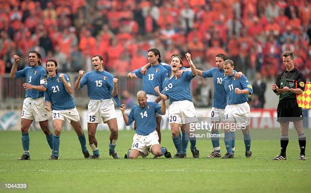 Italy celebrate during the penalty shoot-out at the European Championships 2000 Semi Final at the Amsterdam ArenA, Amsterdam, Holland. The match was...