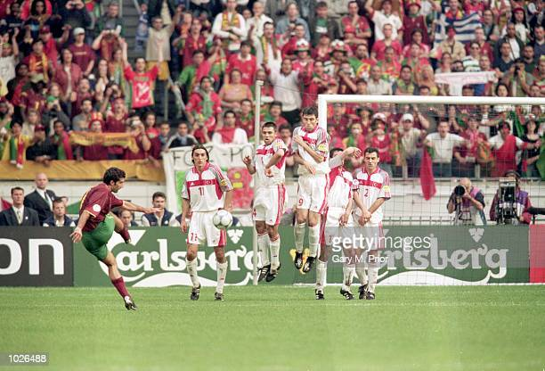 Luis Figo of Portugal strikes a free-kick at goal during the European Championships 2000 Quarter Final match against Turkey at the Amsterdam ArenA,...