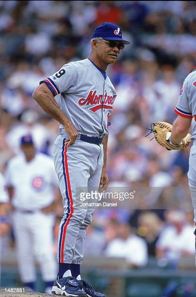 Manager Felipe Alou of the Montreal Expos looks on from the mound during the game against the Chicago Cubs at Wrigley Field in Chicago Illinois The...