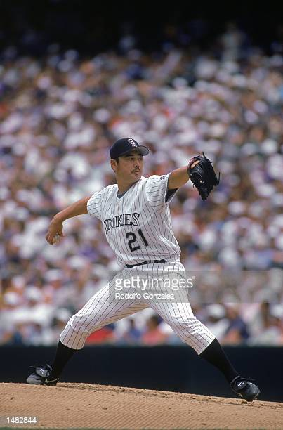 Masato Yoshii of the Colorado Rockies winds back to pitch the ball during a game against the Arizona Diamondbacks at Coors Field in Denver Colorado...