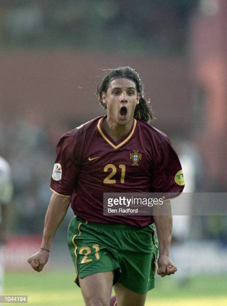 Nuno Gomes of Portugal celebrates during the European Championships 2000 semifinal against France at the King Baudouin Stadium in Brussels Belgium...