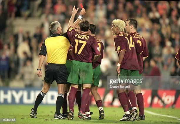 Nuno Gomes of Portugal is sent off by referee Gunter Benko during the European Championships 2000 semifinal against France at the King Baudouin...