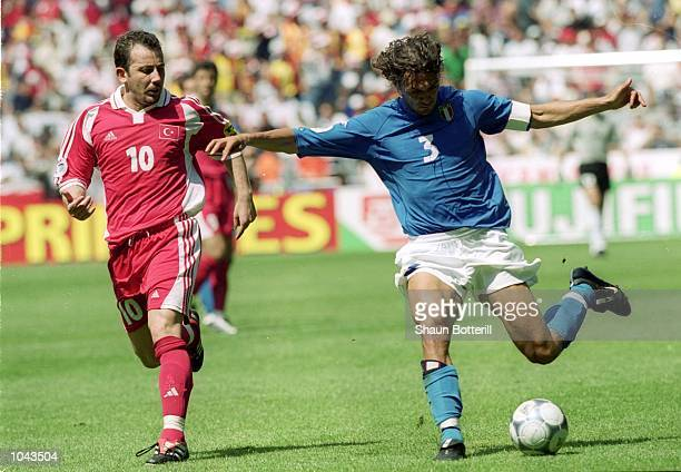 Paolo Maldini of Italy controls the ball ahead of Sergen Yalcin of Turkey during the European Championships 2000 Group B match at the Gelredome...