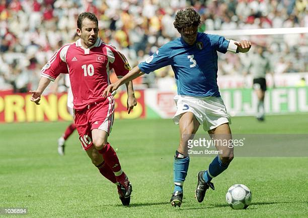 Paolo Maldini of Italy holds off Sergen Yalcin of Turkey during the European Championships 2000 group match at the Gelredome in Arnhem Holland Italy...