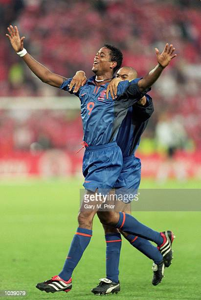 Patrick Kluivert celebrates with Michael Reizeger of Holland during the European Championships 2000 Group Stage against Denmark at the Amsterdam...