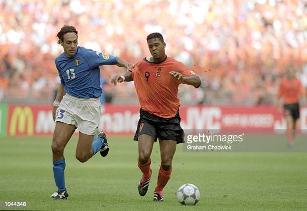 Patrick Kluivert of Holland is being held by Alessandro Nesta of Italy during the European Championships 2000 Semi-final at the Amsterdam ArenA,...
