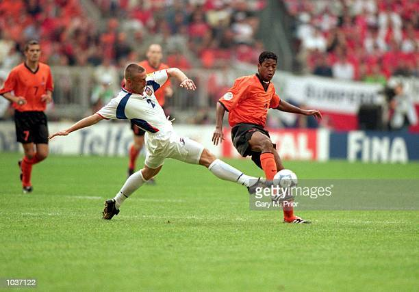 Patrick Kluivert of Holland is challenged by Tomas Repka of the Czech Republic during the European Championships 2000 group match at the Amsterdam...