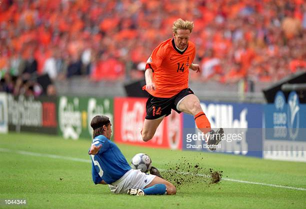 Peter van Vossen of Holland is tackled by Fabio Cannavaro of Italy during the European Championships 2000 Semifinal at the Amsterdam ArenA Amsterdam...