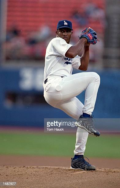 Pitcher Carlos Perez of the Los Angeles Dodgers winds up for the pitch during the game against the Arizona Diamondbacks at Dodgers Stadium in Los...