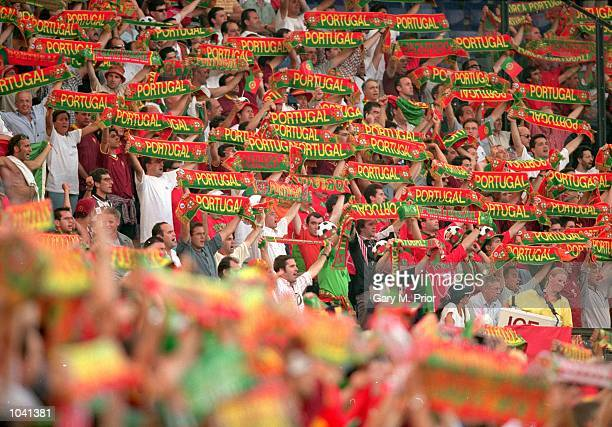 Portugal fans enjoy the action during the European Championships 2000 group match against Germany at the De Kuip Stadium in Rotterdam, Holland....