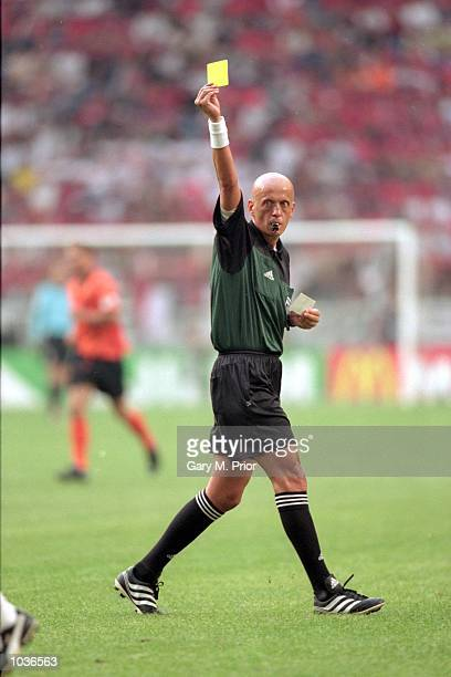 Referee Pierluigi Collina shows a yellow card during the European Championships 2000 group match between Holland and the Czech Republic at the...