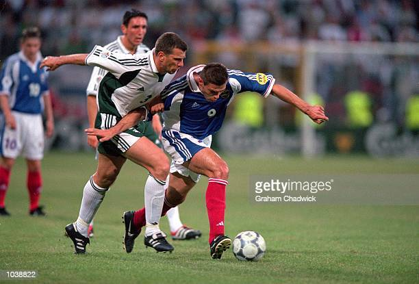 Savo Milosevic of Yugoslavia holds off Zeljko Milinovic of Slovenia during the European Championships 2000 group match at the Stade Communal in...