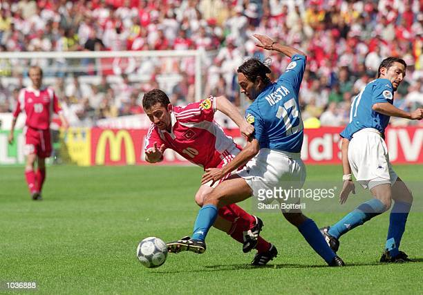 Sergen Yalcin of Turkey is challenged by Alessandro Nesta of Italy during the European Championships 2000 group match at the Gelredome in Arnhem...
