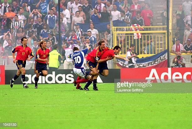 Spain celebrate during the European Championships 2000 group match against Yugoslavia at the Jan Breydal Stadium in Brugge, Belgium. Spain won the...