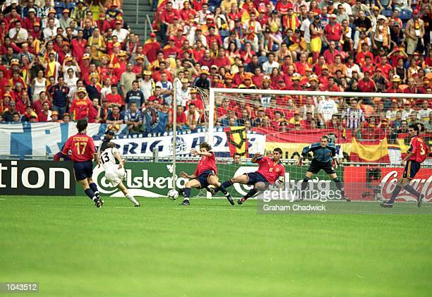 Spain defend a Slovenia attack during the European Championship 2000 Group C match at the Amsterdam ArenA Amsterdam Holland Slovenia won 21 Mandatory...