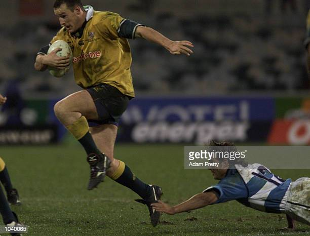 Stirling Mortlock of Australia jumps the tackle of Lisandro Arbizu of Argentina during the second test between Australia and Argentina at Bruce...