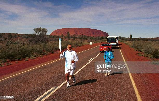 The Olympic Torch Relay travels past the Docker River Road after it's lighting at ''Uluru'' on the first stage of the Olympic Torch Relay in...