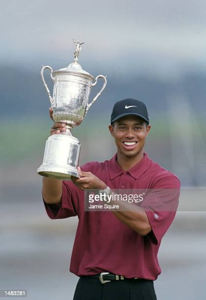 Tiger Woods poses with his trophy after winning the 100th US Open at the Pebble Beach Golf Links in Pebble Beach, California.Mandatory Credit: Jamie...