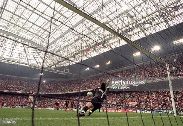 Vitor Baia of Portugal saves penalty from Erdem Arif of Turkey during the European Championships 2000 Quarter Final at the Amsterdam ArenA Amsterdam...